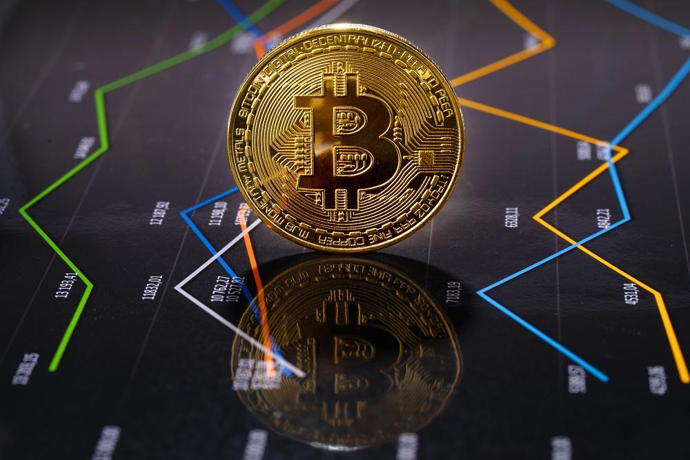 imagem de uma moeda de Bitcoin simulando o investimento em criptomoedas