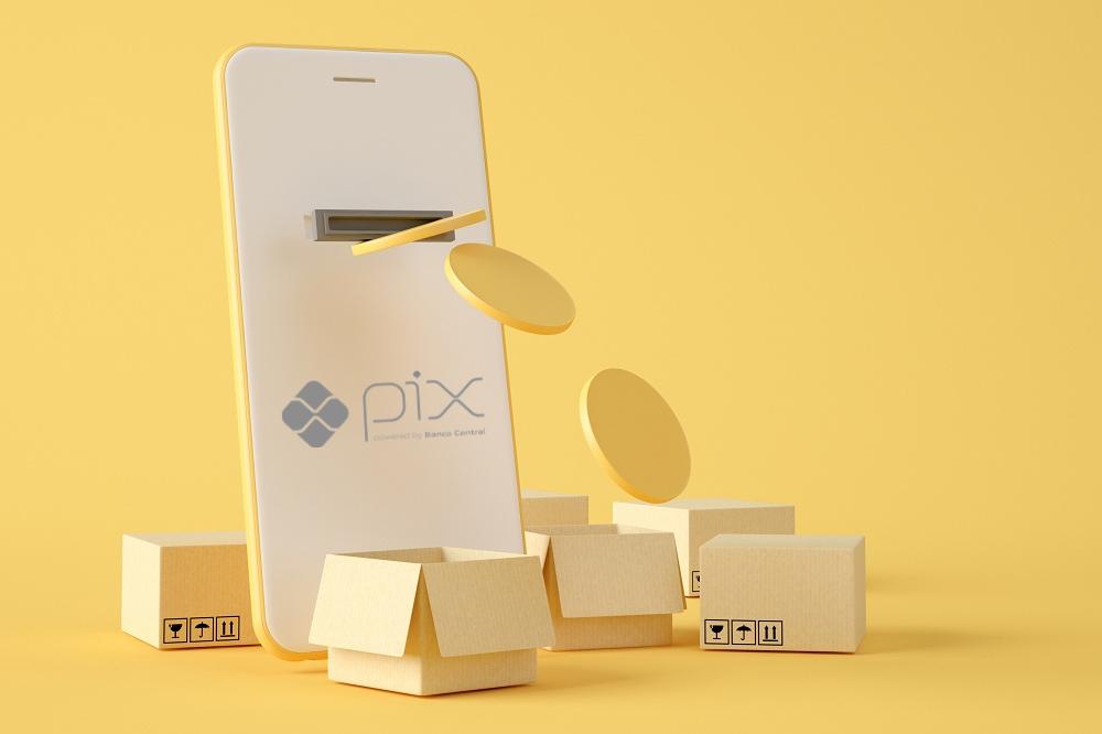 celular saindo moeda digital com o logo do pix
